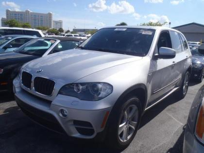 export used 2011 bmw x5 xdrive35i silver on black. Black Bedroom Furniture Sets. Home Design Ideas